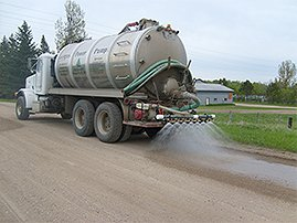 Fergus Power Pump truck applying road stabilization product to road